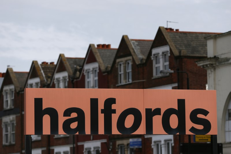 A Halfords sign is seen outside a store in London