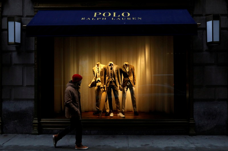 FILE PHOTO: A man walks past Ralph Lauren Corp.'s  flagship Polo store on Fifth Avenue in New York