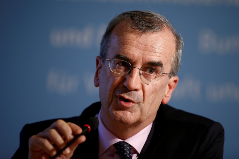 FILE PHOTO: Governor of the Bank of France attends a news conference in Berlin