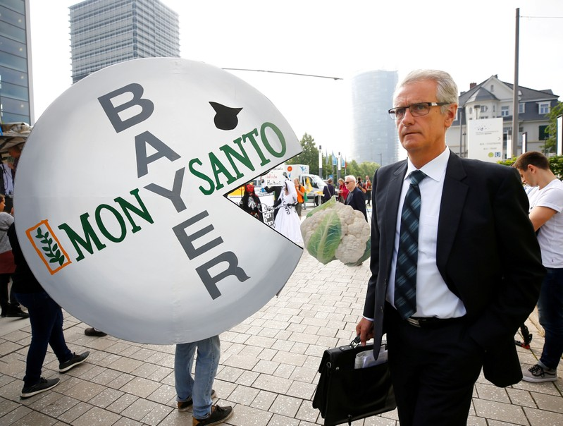 A Bayer's shareholder arrives at the annual general shareholders meeting in Bonn