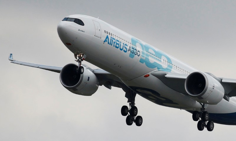 An Airbus A330neo aircraft lands during its maiden flight event in Colomiers near Toulouse, France