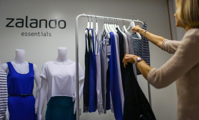 FILE PHOTO: An employee poses in a showroom of the fashion retailer Zalando in Berlin, Germany.