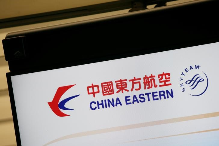 The logo of China Eastern Airlines is shown on a panel at a check-in counter at Hong Kong Airport in Hong Kong
