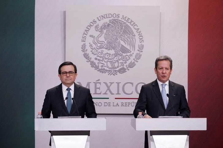 Mexico's Economy Minister Ildefonso Guajardo listens to Mexico's Presidential spokesman Eduardo Sanchez during a news conference at Los Pinos presidential residence in Mexico City
