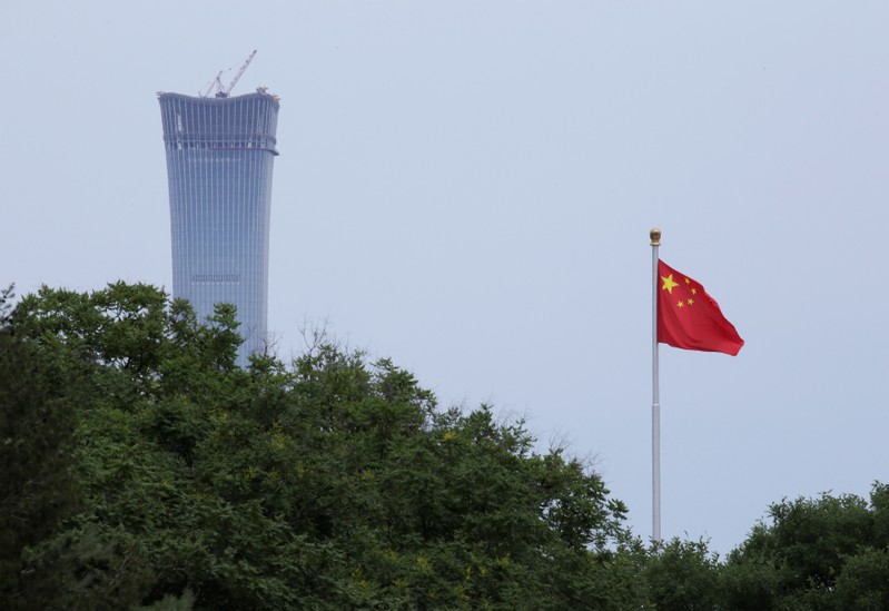 A Chinese flag flutters at Tiananmen Square in central Beijing