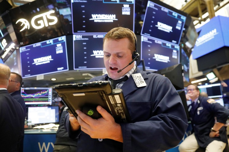 A trader works on the floor of the New York Stock Exchange shortly after the opening bell in New York