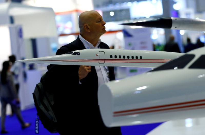 FILE PHOTO: A visitor looks at the AS2 supersonic business jet replica on the Aerion Corporation booth during EBACE in Geneva