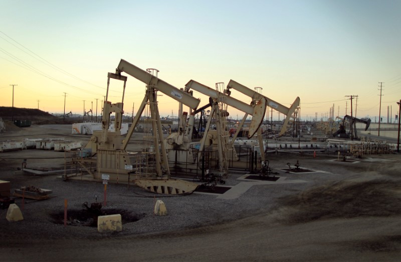 FILE PHOTO: Oil rig pumpjacks extract crude from the Wilmington Field oil deposits area where Tidelands Oil Production Company operates near Long Beach, California