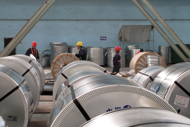 FILE PHOTO: Workers pack cold rolled steel coil at a steel company in Zhangjiagang
