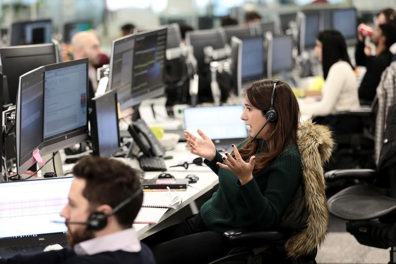 A broker reacts on the IG Index the trading floor