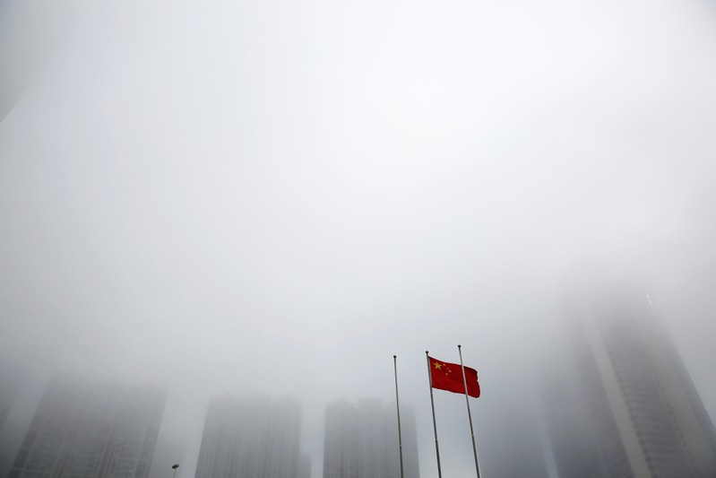 A Chinese flag is seen at a hazy day at the Shanghai Cooperation Organization (SCO) summit media center, in Qingdao