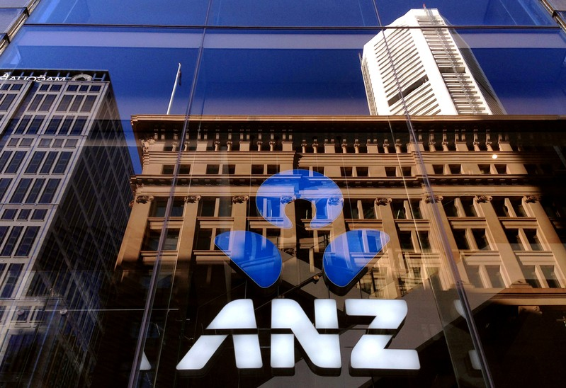 FILE PHOTO - The logo of the ANZ Banking Group is displayed in the window of a newly opened branch in central Sydney, Australia