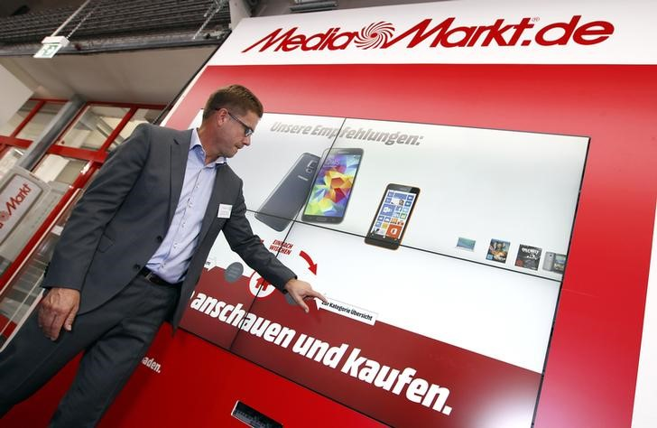 Wolfgang Kirsch, CEO of Media-Saturn Germany uses a huge online product information screen in the European state-of-the-art store of German electronics retailer Media-Saturn after a news conference at the headquarters in Ingolstadt