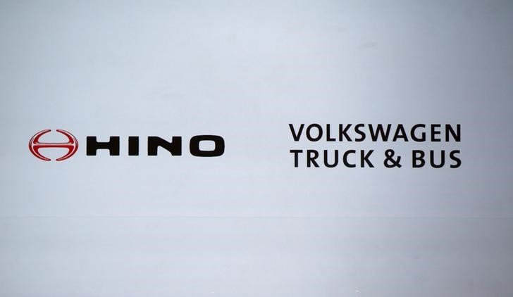Logos of Hino Motors and Volkswagen Truck & Bus GmbH are displayed before their joint news conference in Tokyo