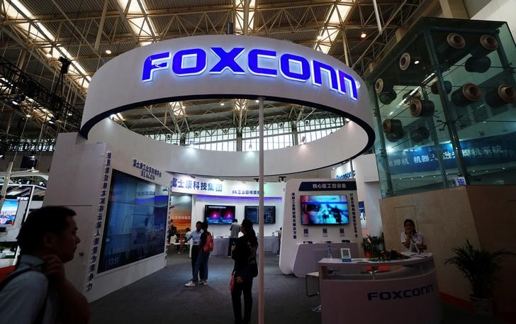 Visitors are seen at a Foxconn booth at the World Intelligence Congress in Tianjin