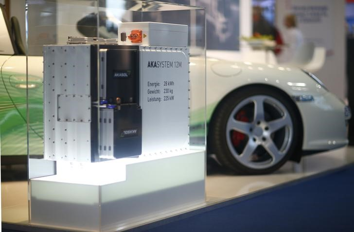 A Lithium-Ion Battery of German manufacturer Akasol is pictured past an electronic car during a media preview day at the Frankfurt Motor Show