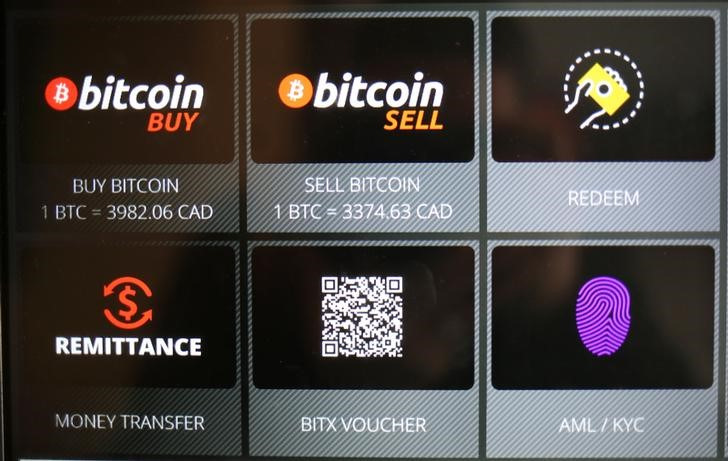 Commands on a Bitcoin ATM are seen at a restaurant in Toronto