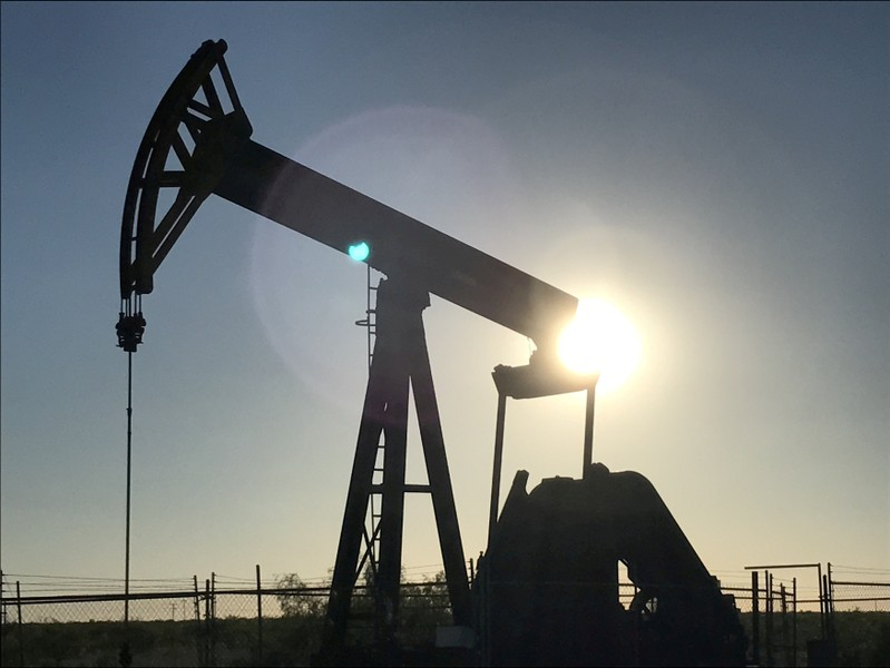 FILE PHOTO: An oil pump jack at sunset near Midland Texas