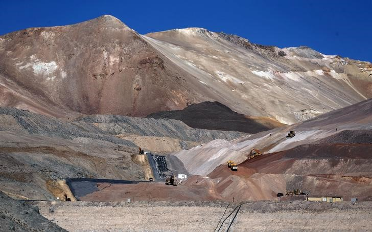 Dump trucks and bulldozers operate at Barrick Gold Corp's Veladero gold mine in Argentina's San Juan province