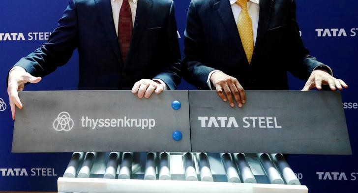 Germany's ThyssenKrupp CEO Hiesinger and Tata Sons Chairman Chandrasekaran pose at a joint news conference in Brussels