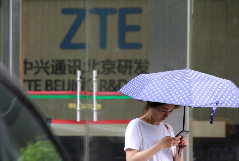 A woman stands outside a building of ZTE Beijing research and development center in Beijing