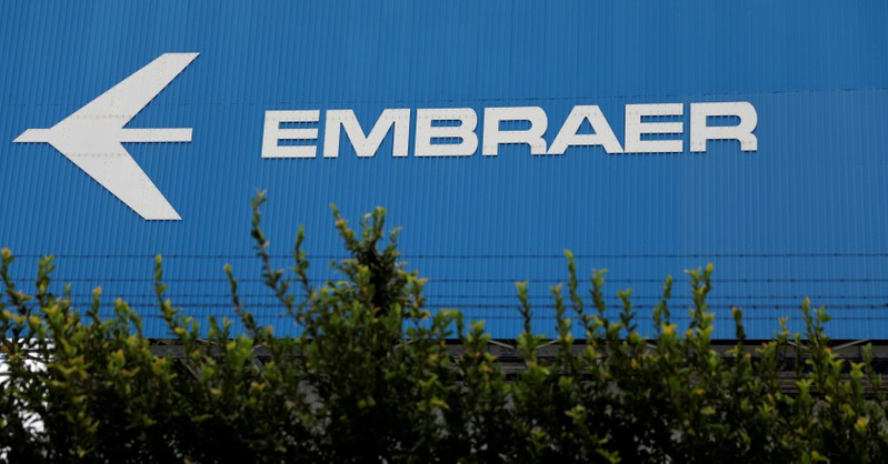 FILE PHOTO: The logo of Brazilian aviation company Embraer is seen on a factory in Sao Jose dos Campos