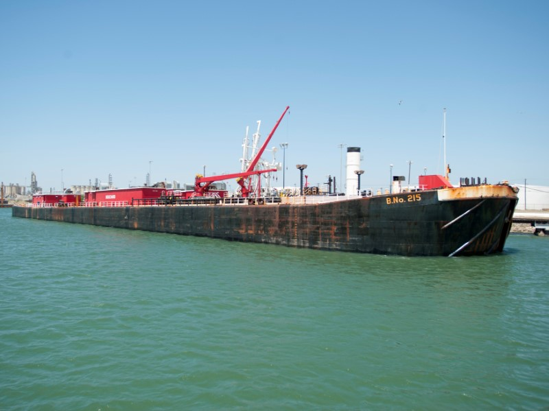 FILE PHOTO:  A seagoing barge is loaded with crude oil from the Eagle Ford Shale formation at the Port of Corpus Christi