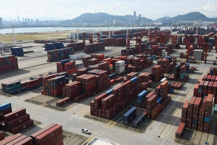 Shipping containers are seen stacked at the Dachan Bay Terminals in Shenzhen