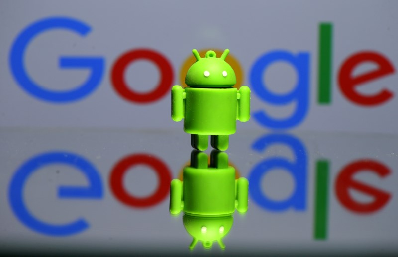 FILE PHOTO - A 3D printed Android mascot Bugdroid is seen in front of a Google logo in this illustration