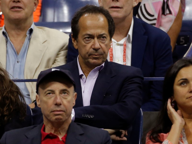 FILE PHOTO: Hedge Fund manager Paulson attends the men's singles final match at the U.S. Open Championships tennis tournament in New York