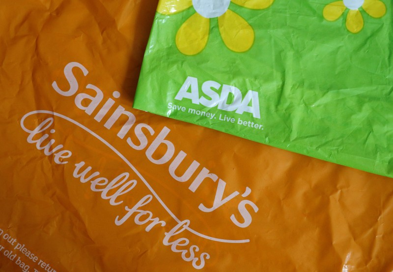 FILE PHOTO: Shopping bags from Asda and Sainsbury's are seen in Manchester.