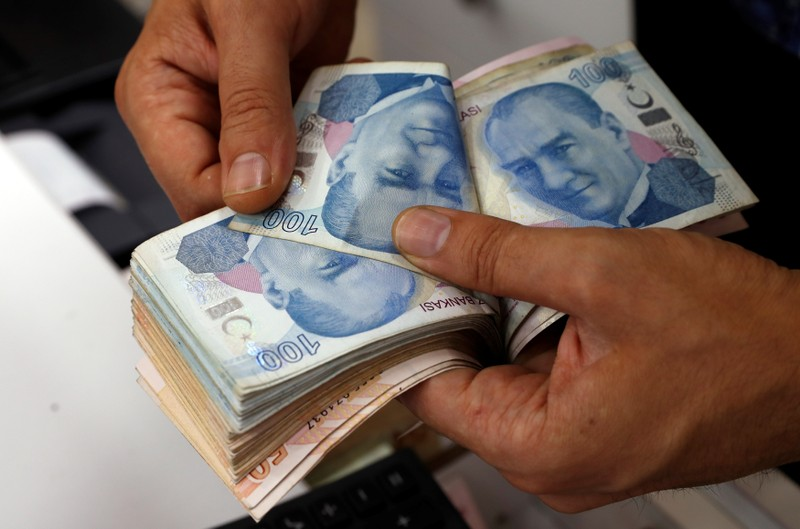 A Money Changer Counts Turkish Lira Banknotes At Currency Exchange Office In Istanbul