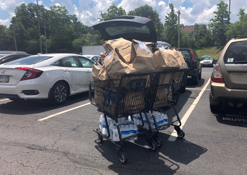 A shopping cart of Whole Foods delivery orders sits ready to be loaded into a car in Cincinnati