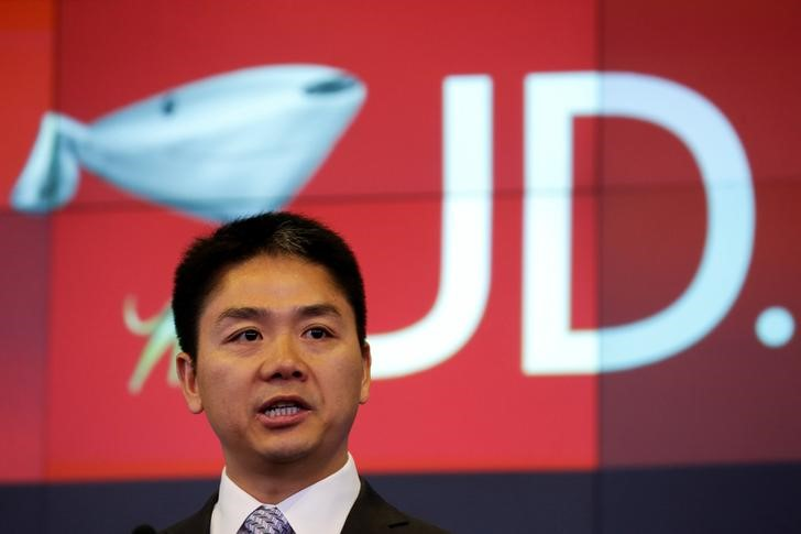 FILE PHOTO: Liu, CEO and founder of JD.com, speaks before ringing the opening bell at the NASDAQ Market Site building in New York