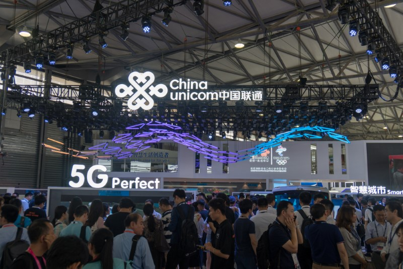 Visitors gather near a 5G stand of China Unicom during the Mobile World Congress (MWC) in Shanghai