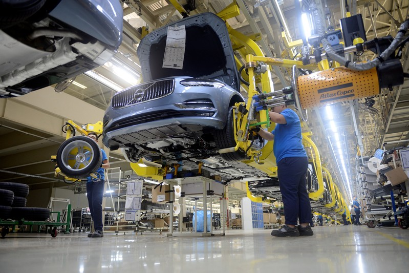 FILE PHOTO: Workers assemble a car at the Volvo Cars manufacturing plant in Daqing