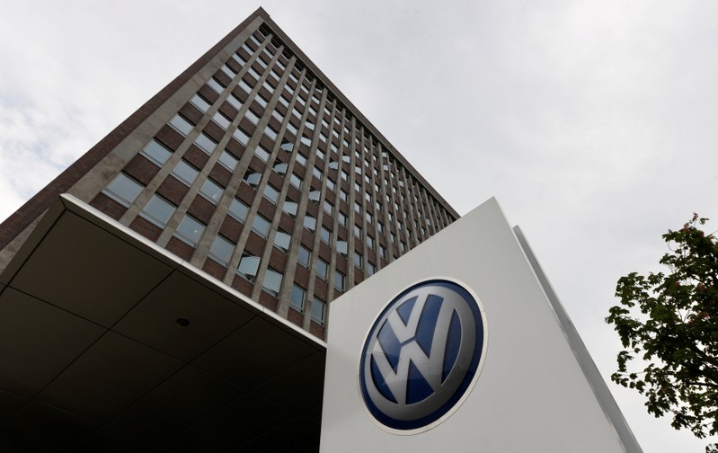 FILE PHOTO: A VW logo is seen in front of the main building of the Volkswagen brand at the Volkswagen headquarters during a media tour to present Volkswagen's so called