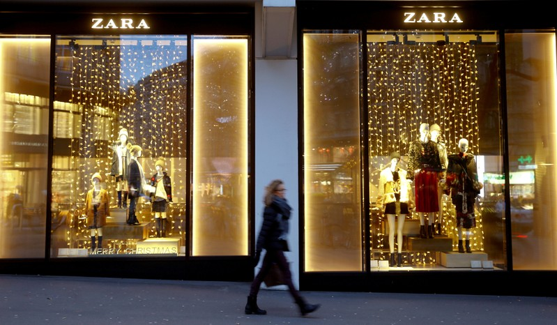FILE PHOTO: Christmas decorations are seen in the windows of a Zara clothing store in Zurich