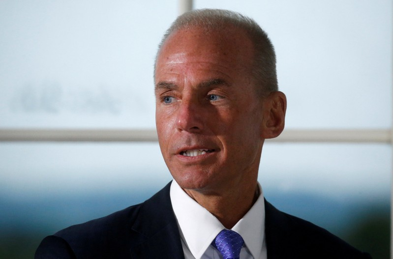 FILE PHOTO: Dennis Muilenburg, president and chief executive officer of The Boeing Company, introduces himself during a dinner with business leaders hosted by U.S. President Donald Trump at Trump National Golf Club in Bedminster