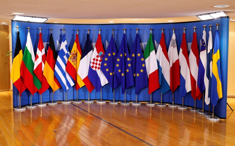 Flags of 16 EU countries are seen ahead of an emergency European Union leaders summit on immigration at the EU Commission headquarters in Brussels