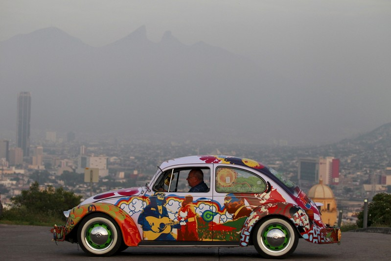 Penia drives his VW Beetle 1995, locally called
