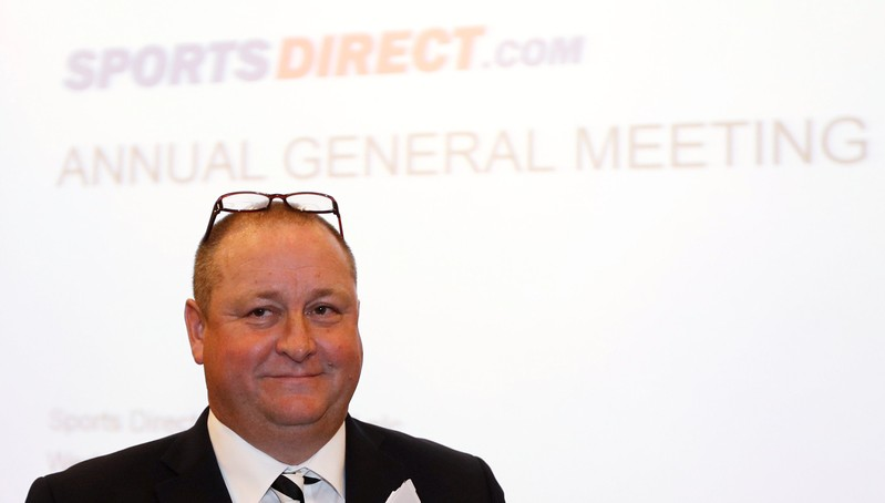 FILE PHOTO: Mike Ashley, founder and majority shareholder of sportwear retailer Sports Direct, arrives at the company's AGM, at the company's headquarters in Shirebrook