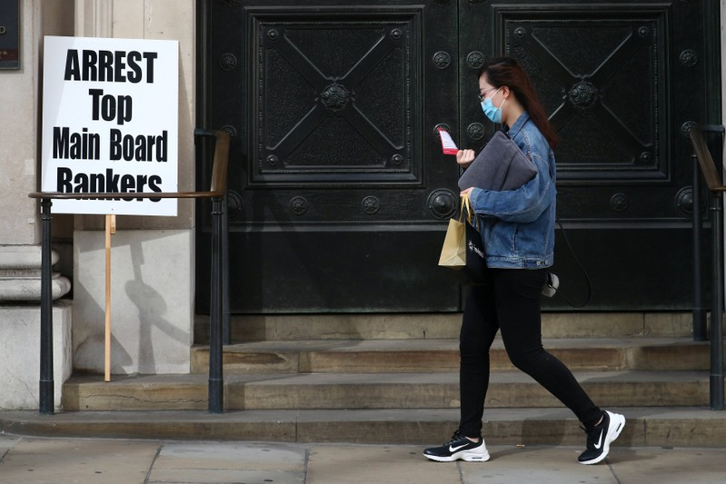 A protest placard is seen after it was left next to the Bank of England after a speech by The Labour Party's shadow Chancellor of the Exchequer, John McDonnell in the City in London