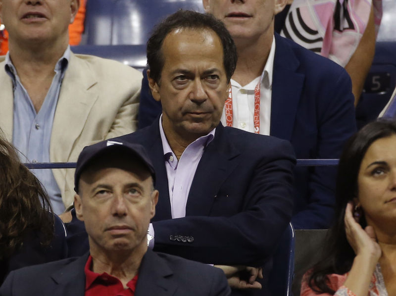 FILE PHOTO - Hedge Fund manager Paulson attends the men's singles final match between Federer of Switzerland and Djokovic of Serbia at the U.S. Open Championships tennis tournament in New York