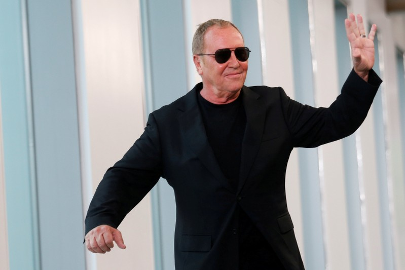 FILE PHOTO: Designer Michael Kors waves after the showing of his Spring/Summer 2019 collection during New York Fashion Week in New York