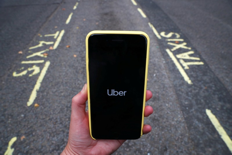 The Uber application is seen on a mobile phone in London