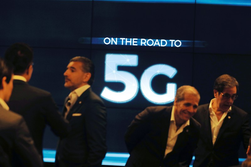 People speak before the first demonstration of the technology 5G in Lisbon