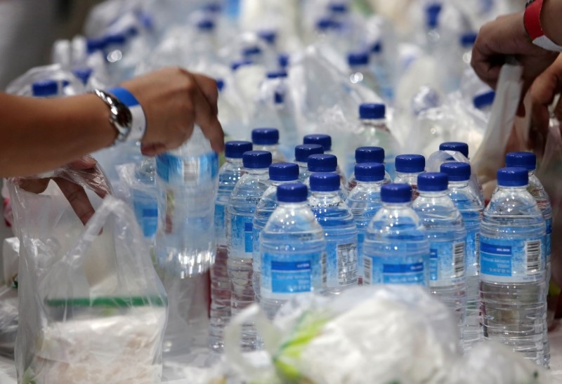 FILE PHOTO: Plastic bags and bottles are given out during an event in Singapore