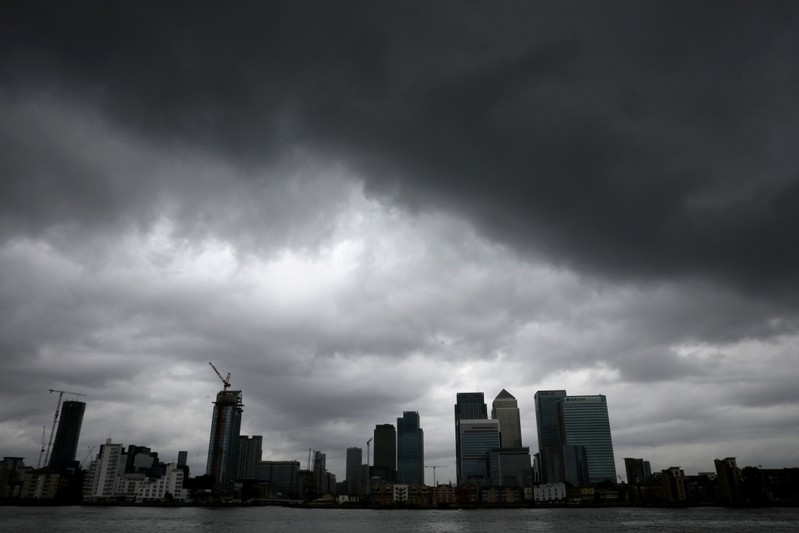 Rain clouds pass over Canary Wharf financial financial district in London