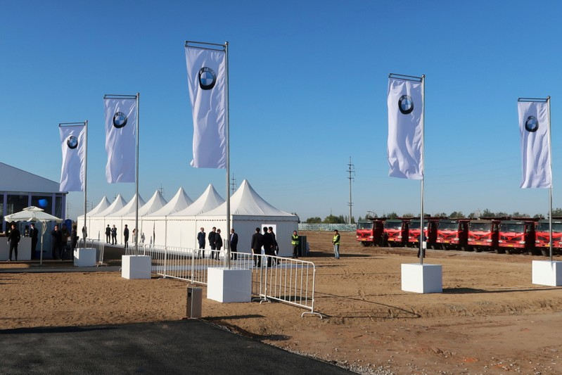 Flags with the logo of BMW flutter at the venue of a ground breaking ceremony for a new BMW assembly plant, inside the BMW Brilliance Plant Tiexi, in Shenyang
